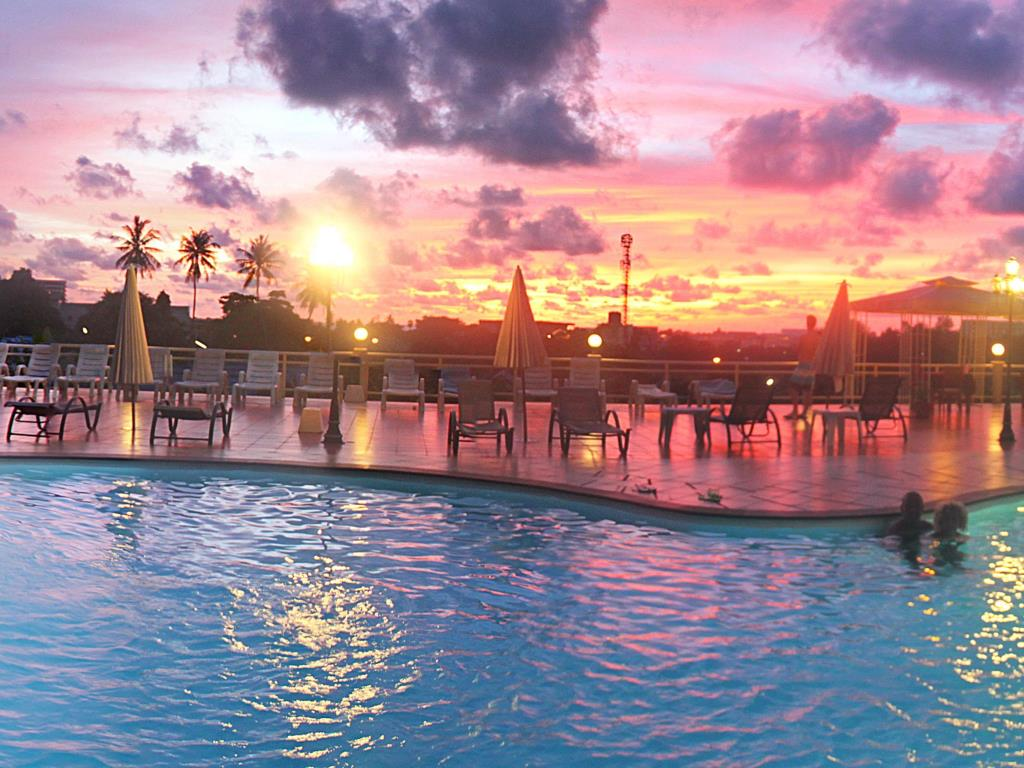 Manohra Cozy Resort Pool Sunset